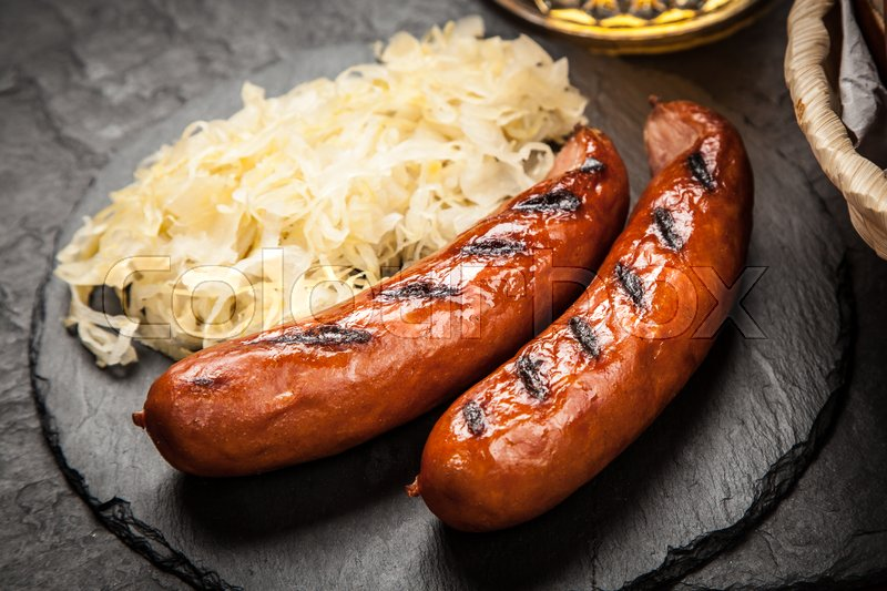 Traditional german food of pretzels sauerkraut bratwurst for Authentic german cuisine