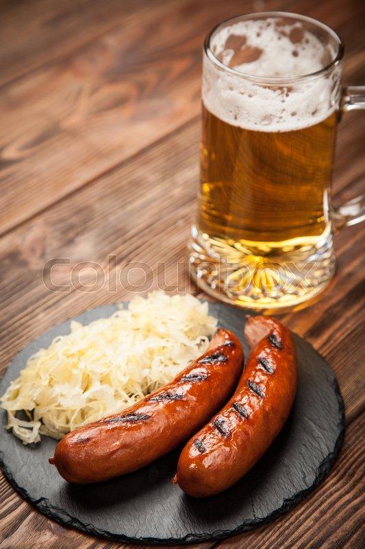 Traditional german food of pretzels sauerkraut bratwurst for Authentic german cuisine