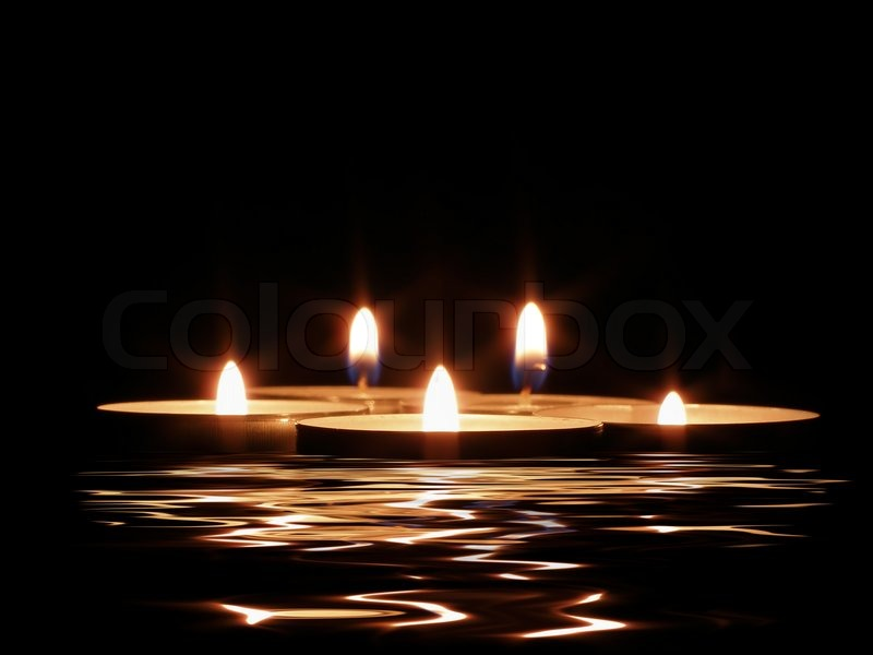 Candles and its reflection in dark water | Stock Photo | Colourbox