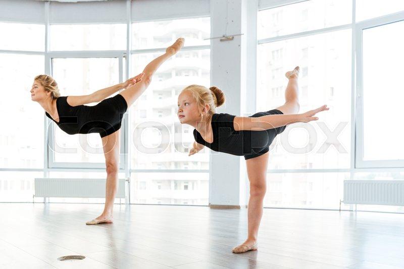 1552507dca85 Woman and little girl ballerina dancing ...