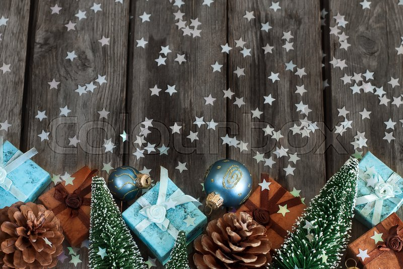 Gift boxes with christmas decoration on wooden table. Copyspace background, stock photo