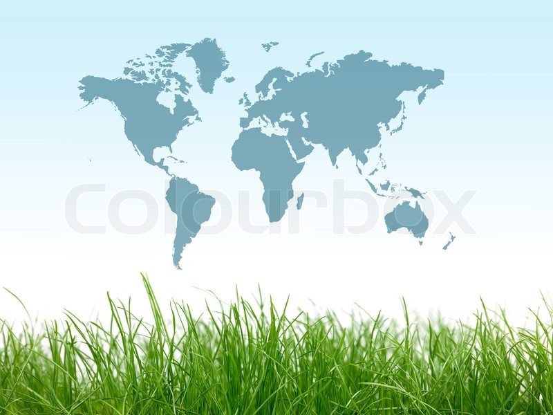 Green grass isolated against a blue sky with a world map, stock photo