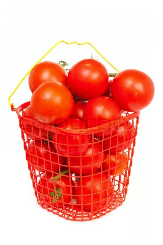 tomaten in einen eimer isoliert auf wei em hintergrund stockfoto colourbox. Black Bedroom Furniture Sets. Home Design Ideas