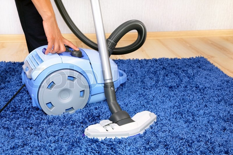 Powelful Vacuum Cleaner In Action A Men Cleaner A Carpet