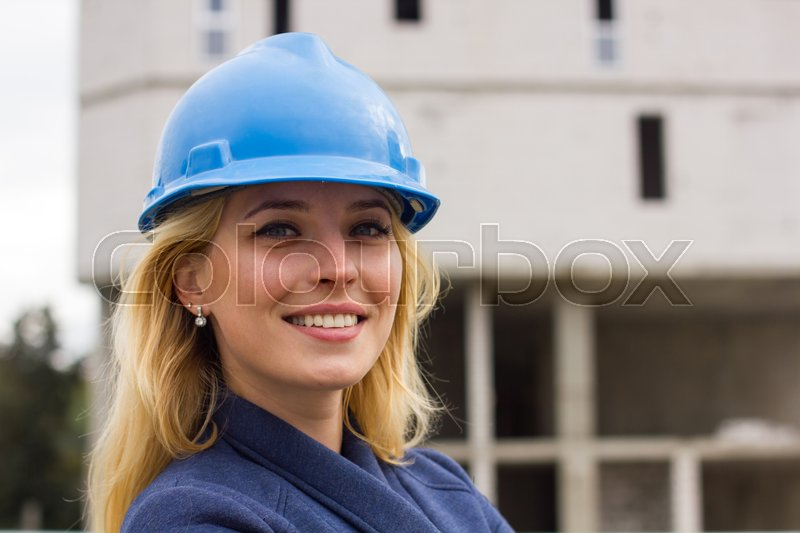 young woman in hardhat on the street stock photo colourbox