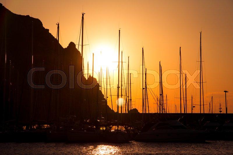 Sea port at sunset warm light, stock photo