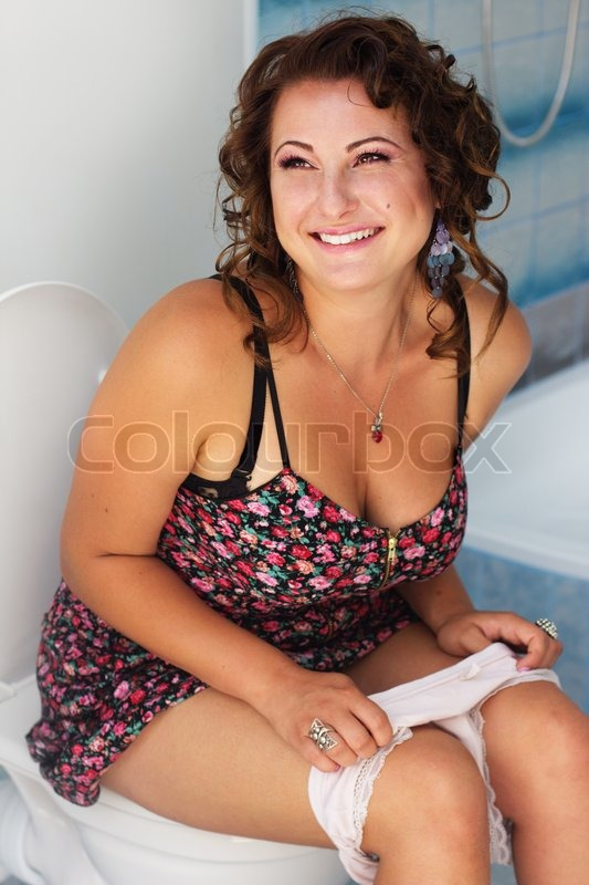 Beautiful Girl Sitting On A Toilet Stock Photo Colourbox