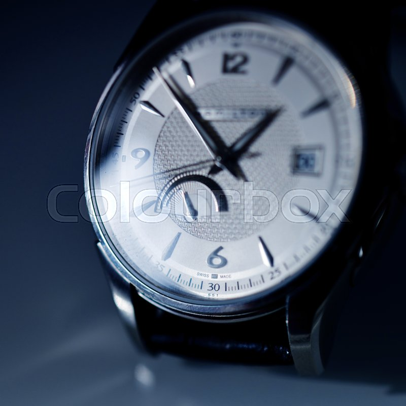 Extreme macro detail of swiss made watch shot with macro lens luxury male accessory for business, stock photo