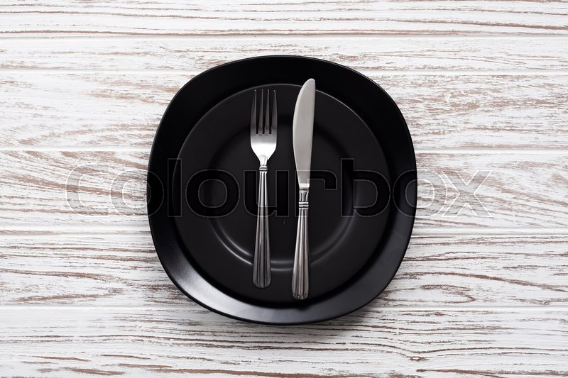 Empty plate fork knife silverware white wooden table background still life vintage flat lay, stock photo