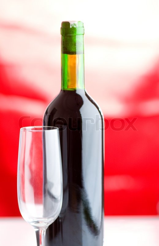 Bottle and wine glass on red background stock photo for Red glass wine bottles suppliers