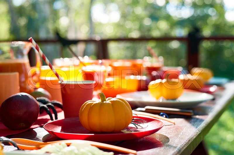 Close-up of table decorated with pumpkins and spiders, stock photo