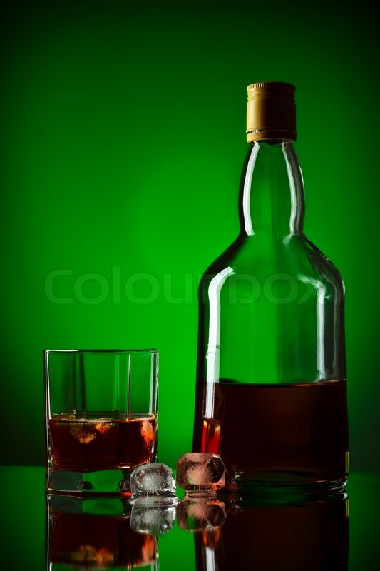Whiskey bottle, ice and glass, green ... | Stock Photo ...