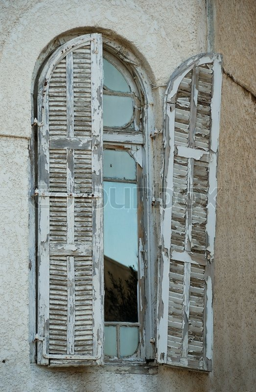 Old Window With Wooden Shabby Paint Shutters In Bauhaus