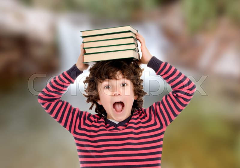 Crazy child with books on his head shouting, stock photo