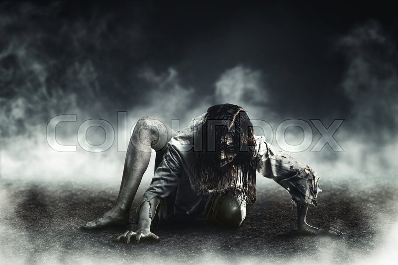 horror witch zombie against the background of the soaring earth halloween stock photo