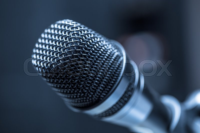 Close-up of microphone in conference room or concert hall, stock photo