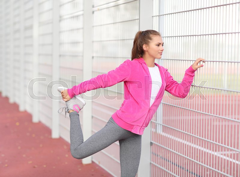 Sport and workout. Girl exercise outdoor, stock photo