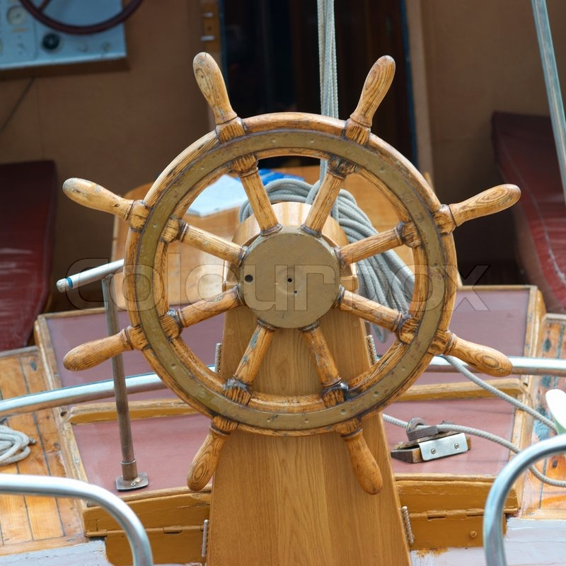 Old wooden steering wheel on the boat | Stock Photo | Colourbox