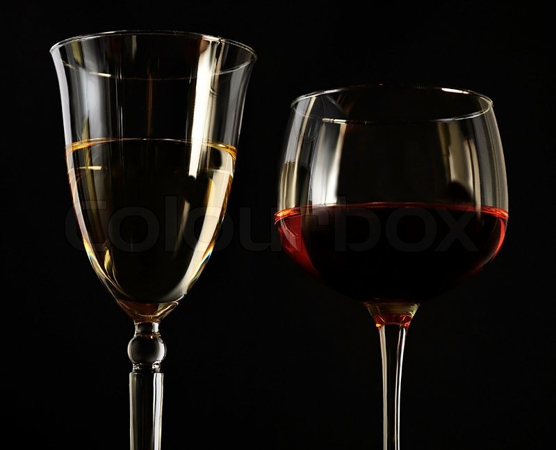 Red and white wine glasses on black background | Stock ...