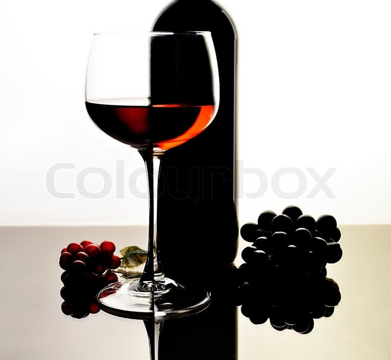 Red wine glass and bottle with reflection stock photo for Red glass wine bottles suppliers