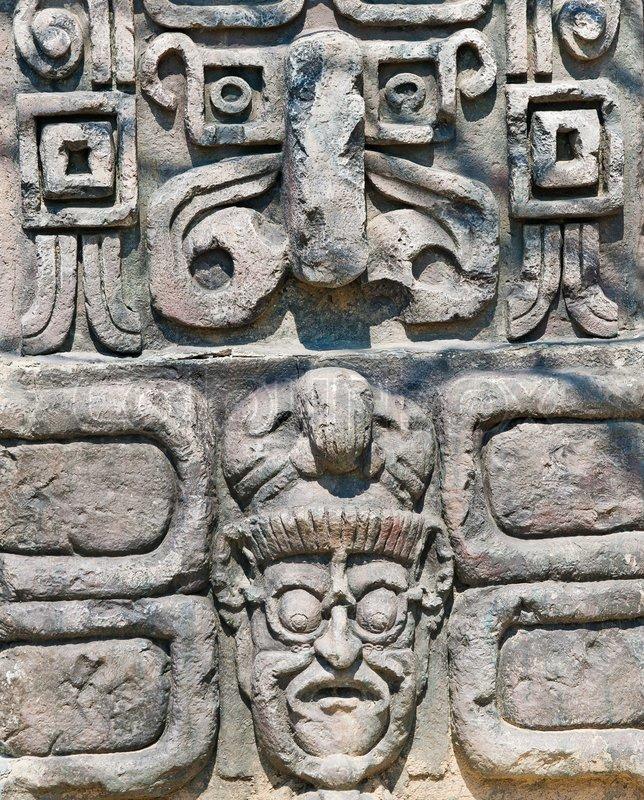 Ancient aztec stone relief background stock photo