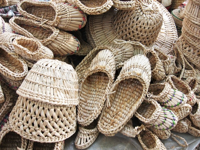 06b6e5b4da1a01 Stock image of 'Showcase wicker products: many sandals, hats, handmade'