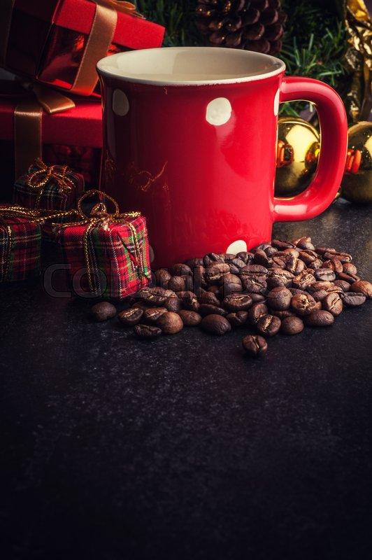 Red mug and Christmas tree with decoration on dark stone background, stock photo