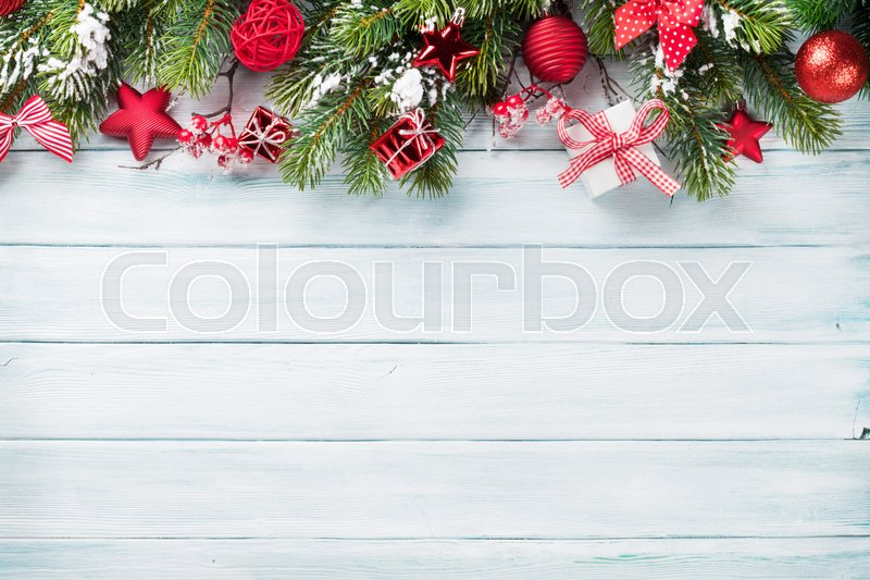 Christmas wooden background with snow fir tree and decoration. Top view with copy space for your text, stock photo