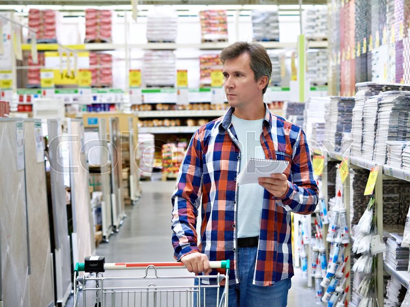 Man in a store building materials, stock photo