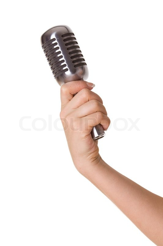 Microphone In Hand : Microphone in female hand isolated on white stock photo