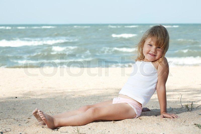 Little girl child on the sea under blue sky | Stock Photo