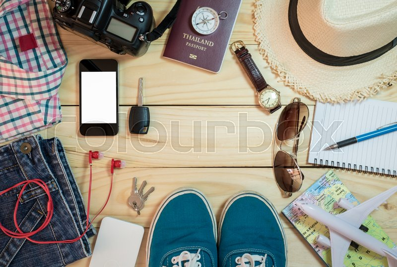 Set of clothes and travel accessory on wooden plank background, Travel concept, stock photo