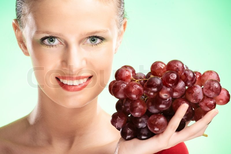 Young Beauty Woman With Grapes On Green Stock Image