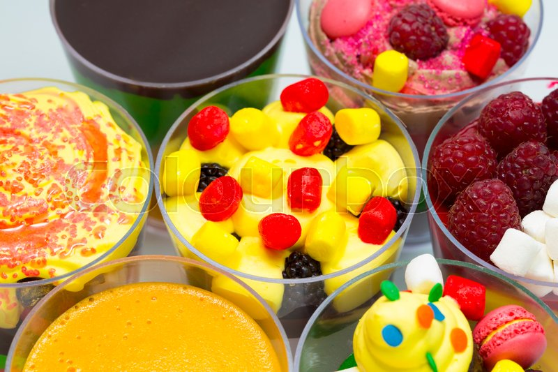 Dessert in plastic cups cream with fruit and pastries and mousse, stock photo