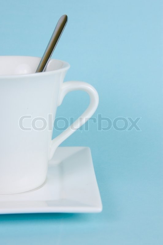 A cup of coffee isolate against a blue background, stock photo
