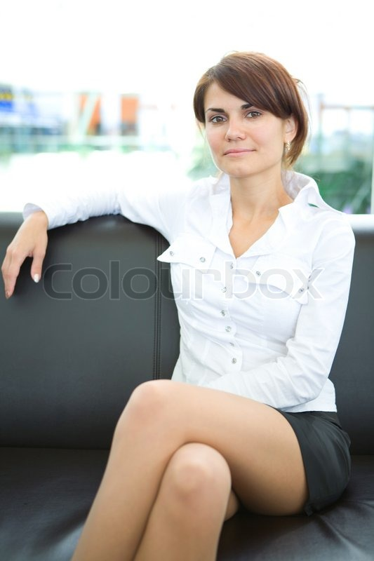 businesswoman head of business sit on skin sofa stock photo colourbox. Black Bedroom Furniture Sets. Home Design Ideas
