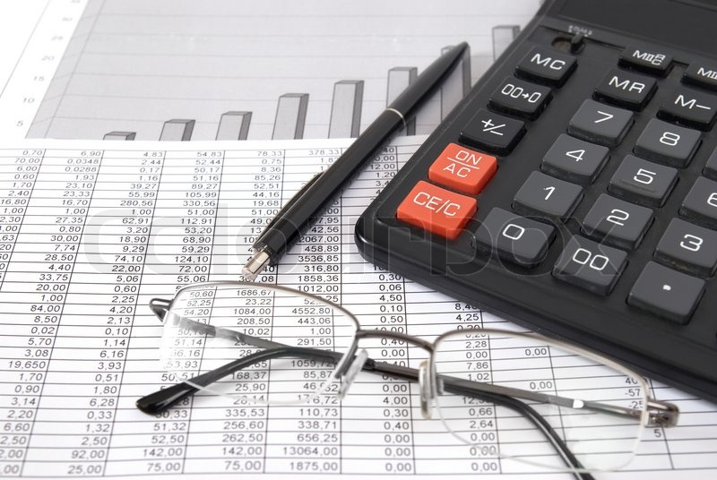 Pen, glasses and calculator on paper table with finance diagram ...