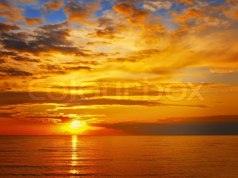 Stock image of 'Bright sunset at the sea'