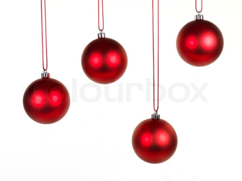 Hanging christmas ornaments isolated against a white for Hanging christmas decorations