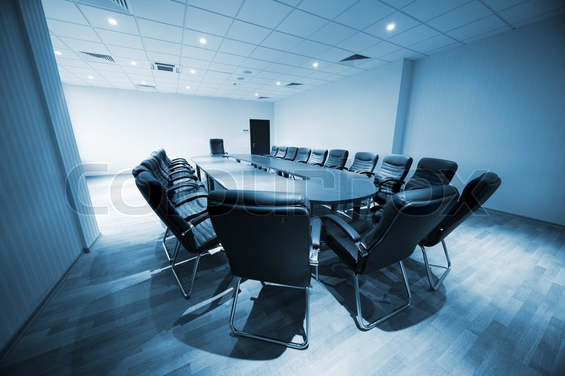 Image of 'a large table and chairs in a modern conference room'