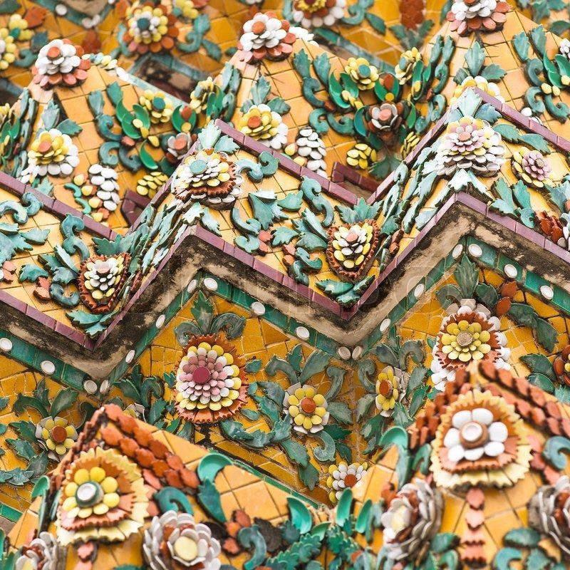 flower mosaic on the buddhist stupa in wat pho temple bangkok