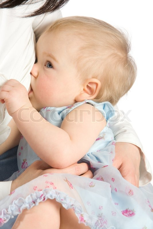 Stock image of 'Baby girl sucking milk from mothers breast'