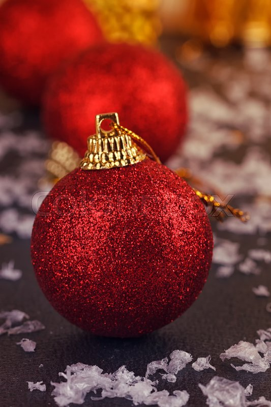 One red satin Christmas ball on black background | Stock Photo ...