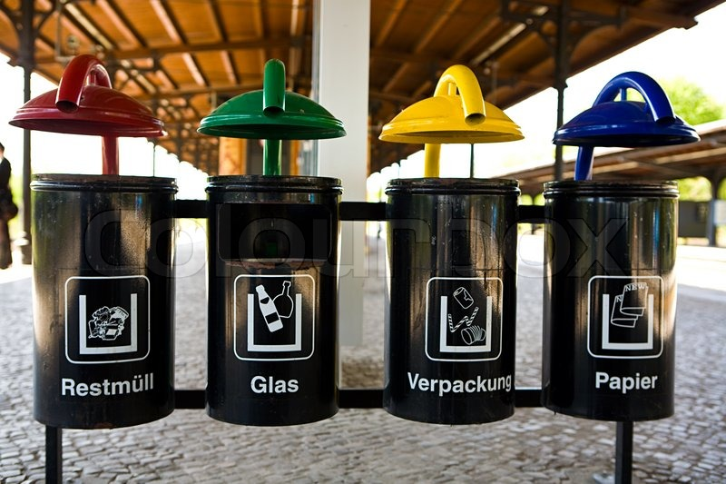 Stock image of 'Color coded trash bins for waste segregation'