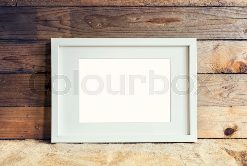 Image of white standing mockup frame on wooden background with ...
