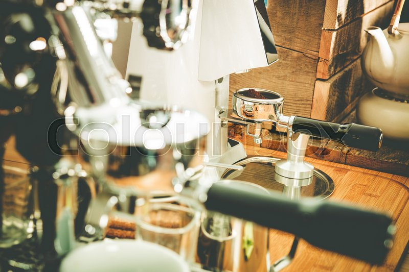 Coffee Making Equipment Closeup Photo. Elegant Shiny Coffee Maker and Grider, stock photo