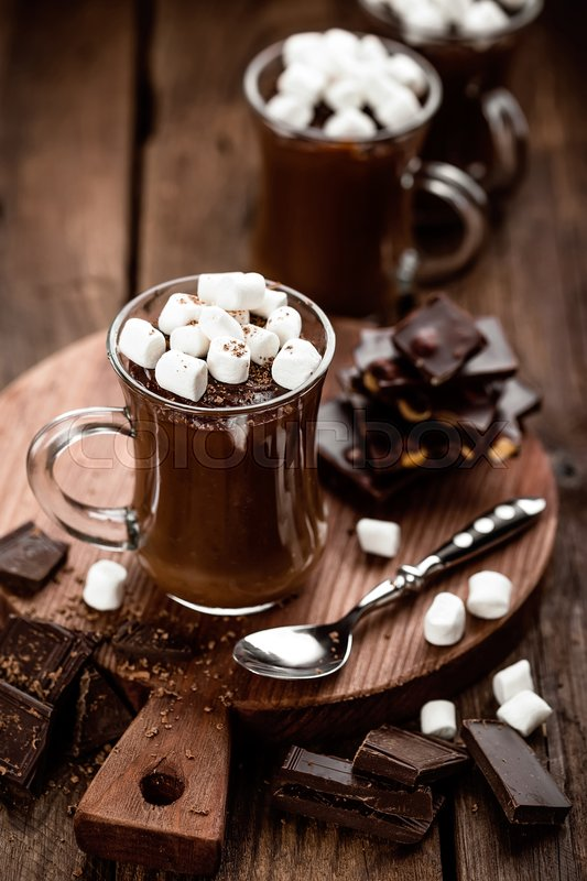 Hot chocolate dessert with marshmallows on wooden background, stock photo