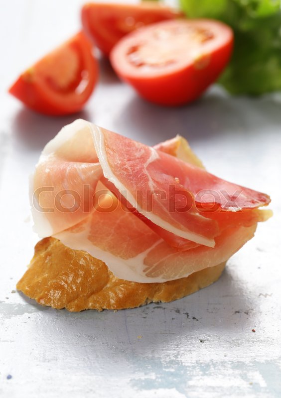 Stock image of 'Appetizer parma ham (jamon) with baguette'
