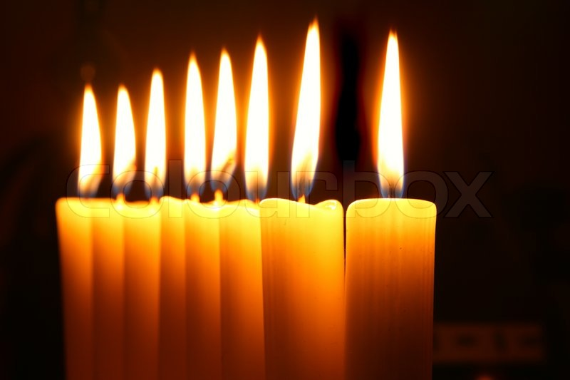 Eight Burning Candles Over Black Background Stock Photo