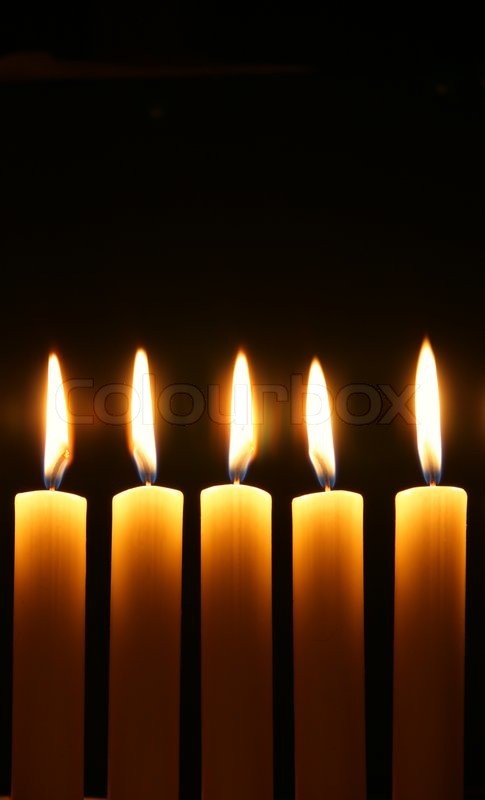 Five Burning Candles Over Black Background Stock Photo